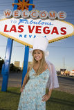 Woman Standing Against 'Welcome To Las Vegas' Sign Royalty Free Stock Images