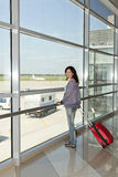 Woman standing  at the airport window . Royalty Free Stock Photography