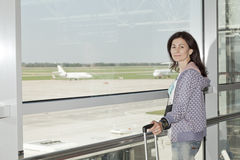 Woman standing  at the airport window . Stock Photography