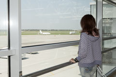 Woman standing  at the airport window . Woman standing  at the airport window Royalty Free Stock Image