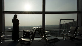 Woman standing at the Airport Window Royalty Free Stock Images
