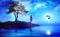 Woman Standing Alone In Fantasy Island. Woman standing alone in a small island surrounded with magical fantasy type of environment with universe and full moon Stock Photography