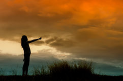 Woman standing alone at the field during  sunset Royalty Free Stock Images