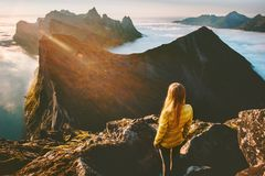 Woman standing alone in sunset mountains hiking outdoor stock images