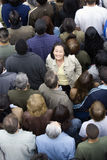 Woman Standing Amidst Around The People Stock Photography