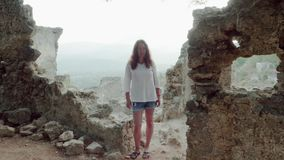 Woman standing on ancient ruins