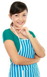 Woman standing with apron Royalty Free Stock Photo