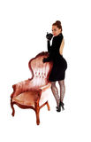 Woman standing on armchair. Stock Photo