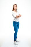 Woman standing with arms folded isolated on a white Royalty Free Stock Photo