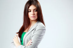 Woman standing with arms folded and looking away Royalty Free Stock Photography