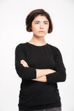 Woman standing with arms folded Stock Image