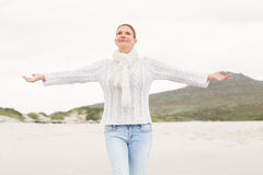 Woman standing with arms open wide Stock Photo