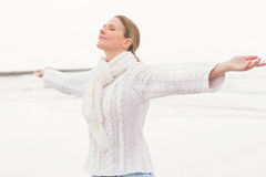 Woman standing with arms open wide Royalty Free Stock Photo