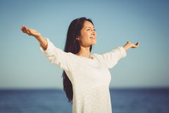 Woman standing with arms outstretched Stock Photography