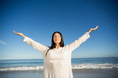 Woman standing with arms outstretched Royalty Free Stock Image