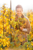 Woman standing in autumn vineyard Royalty Free Stock Photography