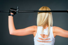 A woman is standing back and holding a sword Stock Photo