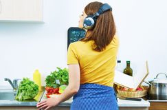Woman standing back in kitchen, cooking healthy fo Royalty Free Stock Photos