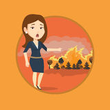 Woman standing on background of wildfire. Royalty Free Stock Images