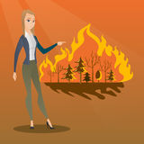 Woman standing on background of wildfire. Stock Photography