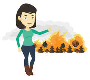 Woman standing on the background of wildfire. Stock Images