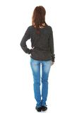 Woman standing backside. With a hand on a hip stock photo