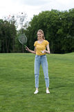Woman standing with badminton racquet and shuttlecock and ready to play royalty free stock photo