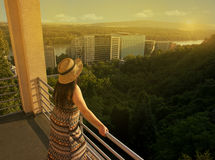 Woman Standing at Balcony. Looking to Distance royalty free stock photography