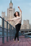 Woman is standing in ballet position Royalty Free Stock Photography