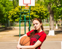 Woman Standing on Basketball Court Holding Ball Royalty Free Stock Images