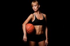 Woman standing with basketball Royalty Free Stock Images