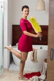 Woman standing in a bathroom Stock Photos