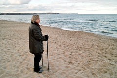 Woman standing on beach Stock Photography