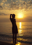 A woman is standing on the beach Stock Photography