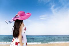 Woman standing on the beach Stock Images