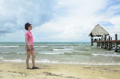 Woman standing on a beach Royalty Free Stock Image
