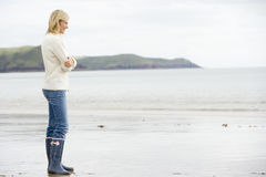 Woman standing on beach Stock Photos