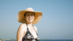 Woman standing on the beach with her fancy hat Royalty Free Stock Images