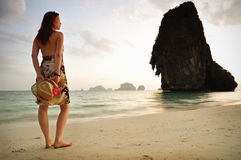 Woman standing at the beach stock photos
