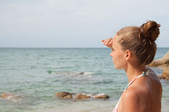 Woman standing on the beach Royalty Free Stock Images