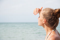 Woman standing on the beach Stock Photos