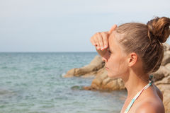Woman standing on the beach Stock Photography