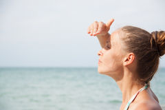 Woman standing on the beach Royalty Free Stock Photos