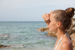 Woman standing on the beach Royalty Free Stock Photography