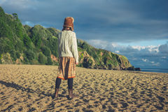 Woman standing on beach at sunset Royalty Free Stock Photography