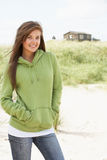 Woman Standing On Beach Wearing Hooded Top Stock Image