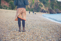Woman standing on beach in winter Stock Photo
