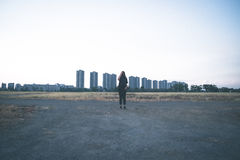 Woman Standing Behind the Big Building Royalty Free Stock Photos