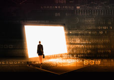 Woman standing on big laptop Stock Photo
