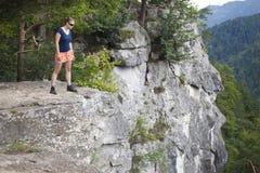 Woman standing on big rock Stock Photos